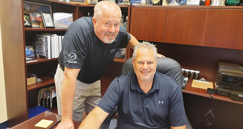 Todd Flis, left, and his younger brother Troy in the Spirit of Daytona shop.